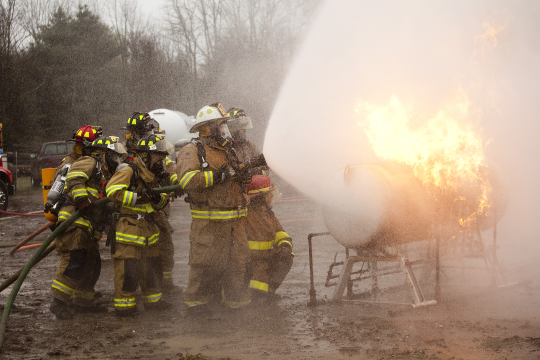Different approach and fire control. Firefighters learn that by adjusting water patterns for existing conditions and utilizing different approach angles they can successfully move a raging fire off th