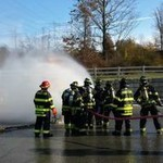 fire fighter spraying hose