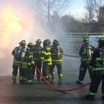 Team of fire fighters going through training
