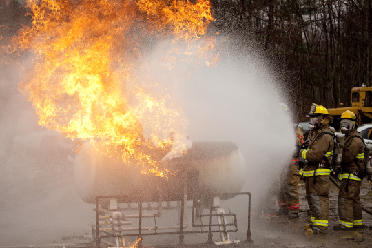 This is a view of a fully involved tank fire. Students learn to successfully move flame impingement off the tank.