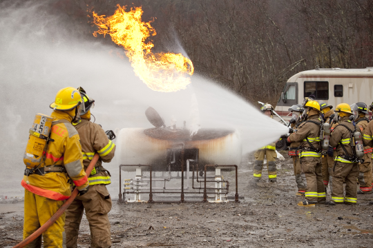 This is an excellent view of fire control at its best. Flame impingement is completely off the tank and the tank is kept cool. Check out the ice cone the liquid travels up the cone moving the fire off