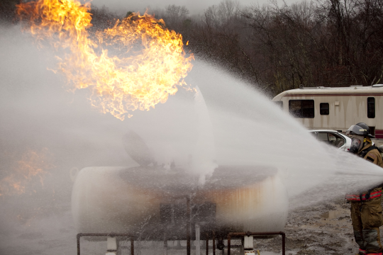 This is neat because you can see the ice cone from the original leak along with two fires that have been successfully controlled and moved off the tank.
