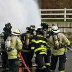 Fire fighters putting out fire